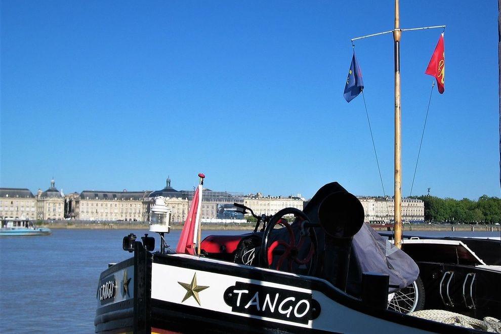 Barge <em>Tango</em> moored in Bordeaux city center at the Port de la Lune