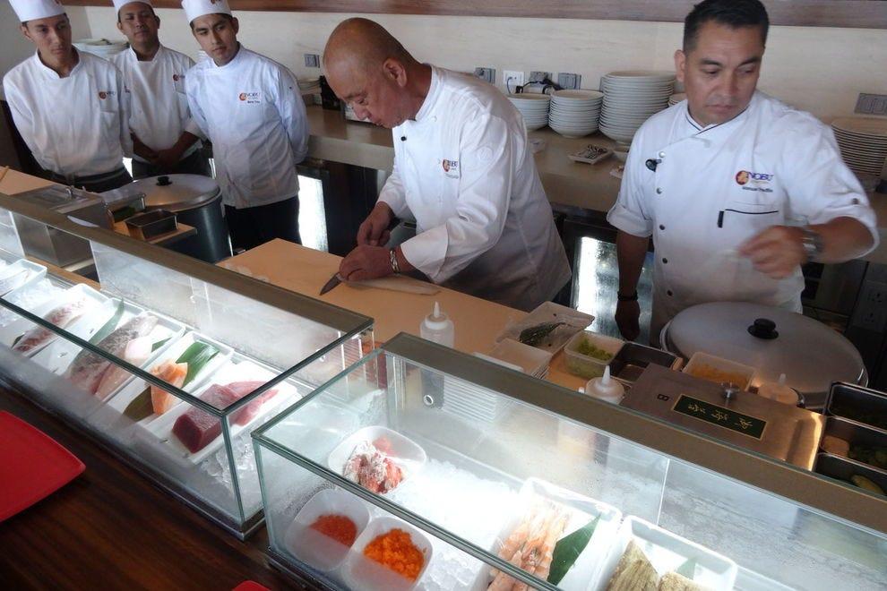 Chef Nobu slicing fish at his Nobu Hotel Los Cabos