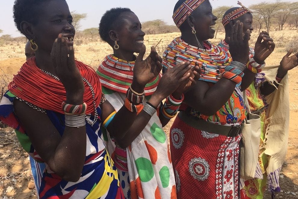 Samburu women greet American women on Global Heart Journeys' Women's Journey to Kenya