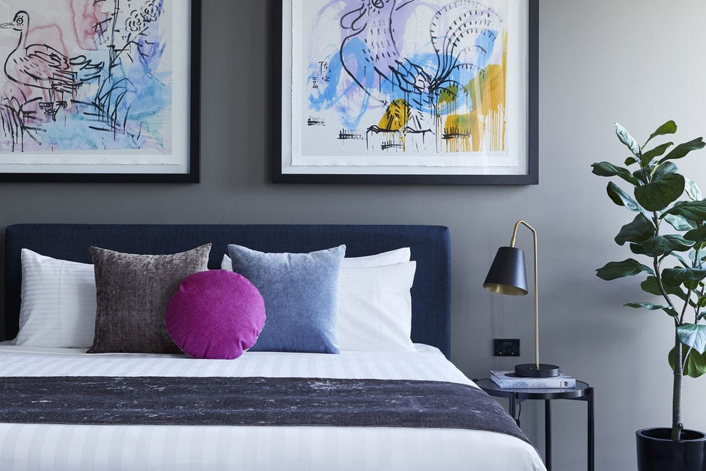 One of the guestrooms showcasing Zhong Chen's colorful work