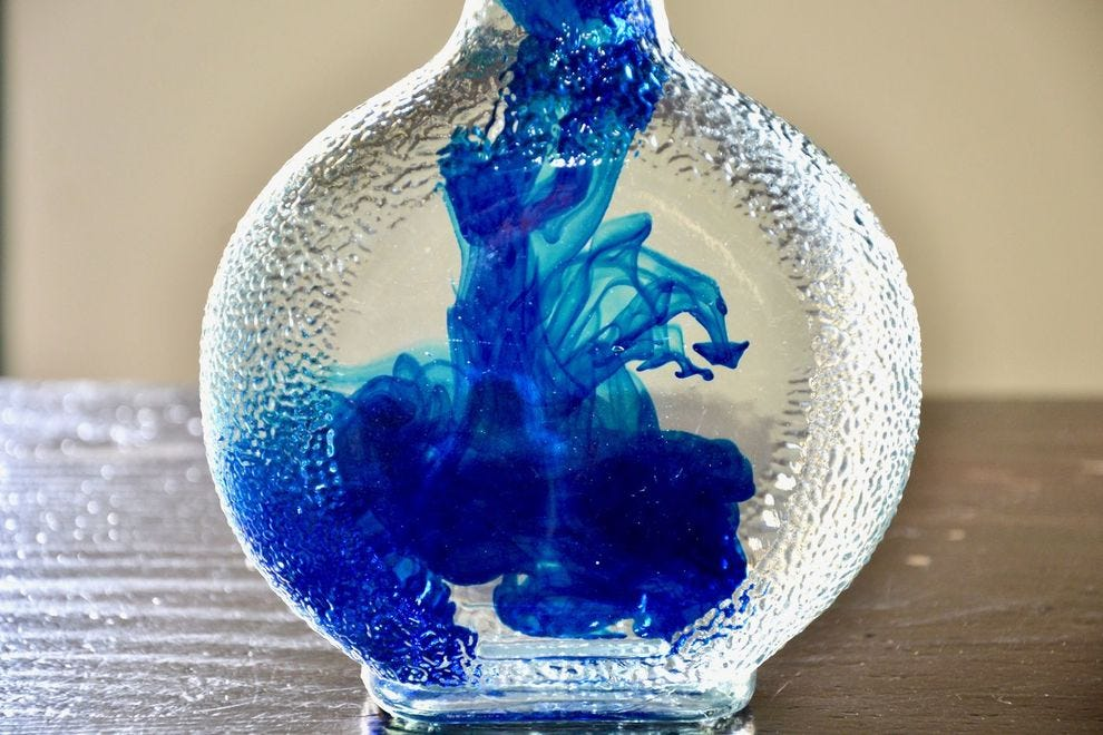 Turning curacao liqueur its signature bright blue shade