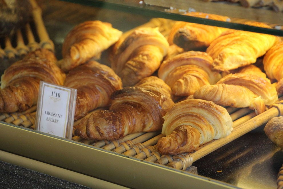 Butter croissants in a bakery case