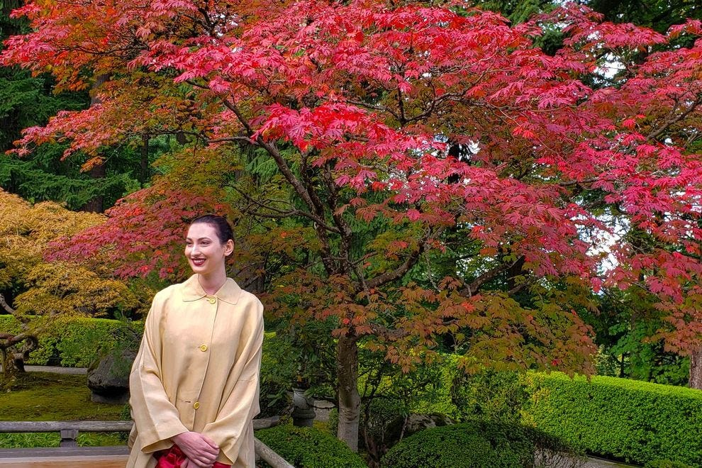 New York City art curator Christina Cacouris takes a moment to enjoy the vibrant colors outside the Garden's pavilion