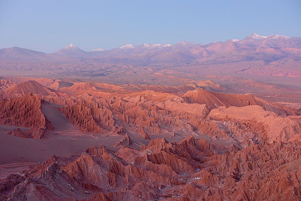 Sunset over the Valle de Marte turns the desert vibrant shades of gold and red