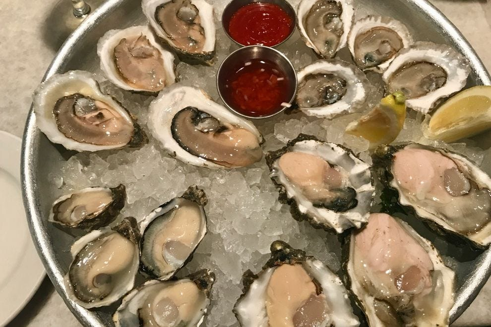 Oysters at Sansom Street Oyster House arrive impeccably shucked.