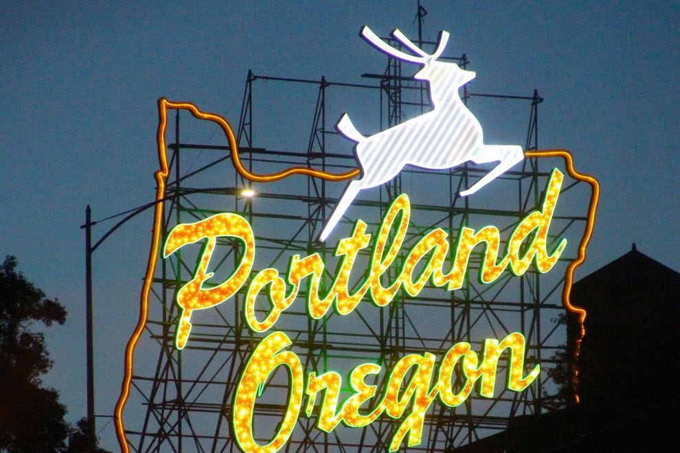 Catch the sign during the holiday season to see the white stag with a red nose
