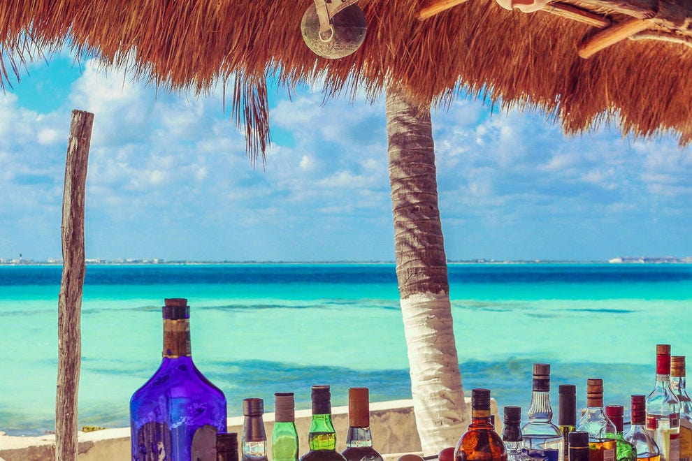 Sip tropical cocktails at these toes-in-the-sand beach bars