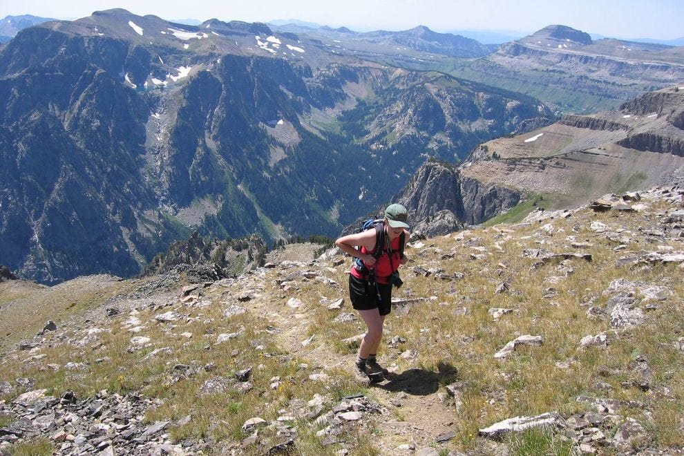 A hiker approaches the top of Static Peak