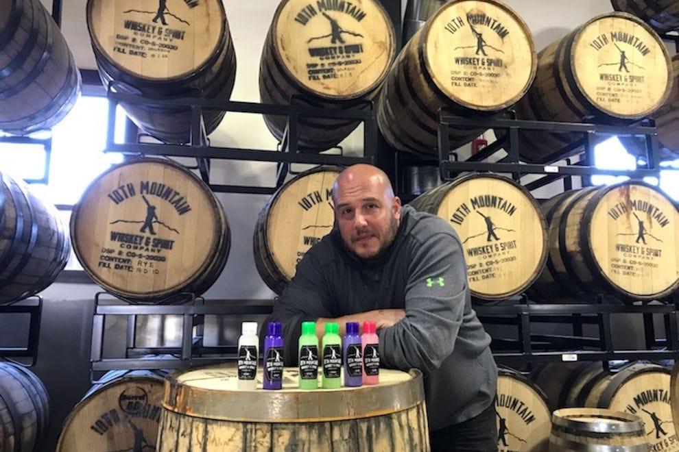 10th Mountain Whiskey & Spirits head distiller Shawn Hogan with hand sanitizer