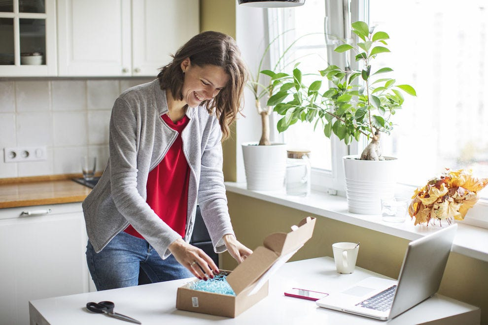 Woman opens subscription box