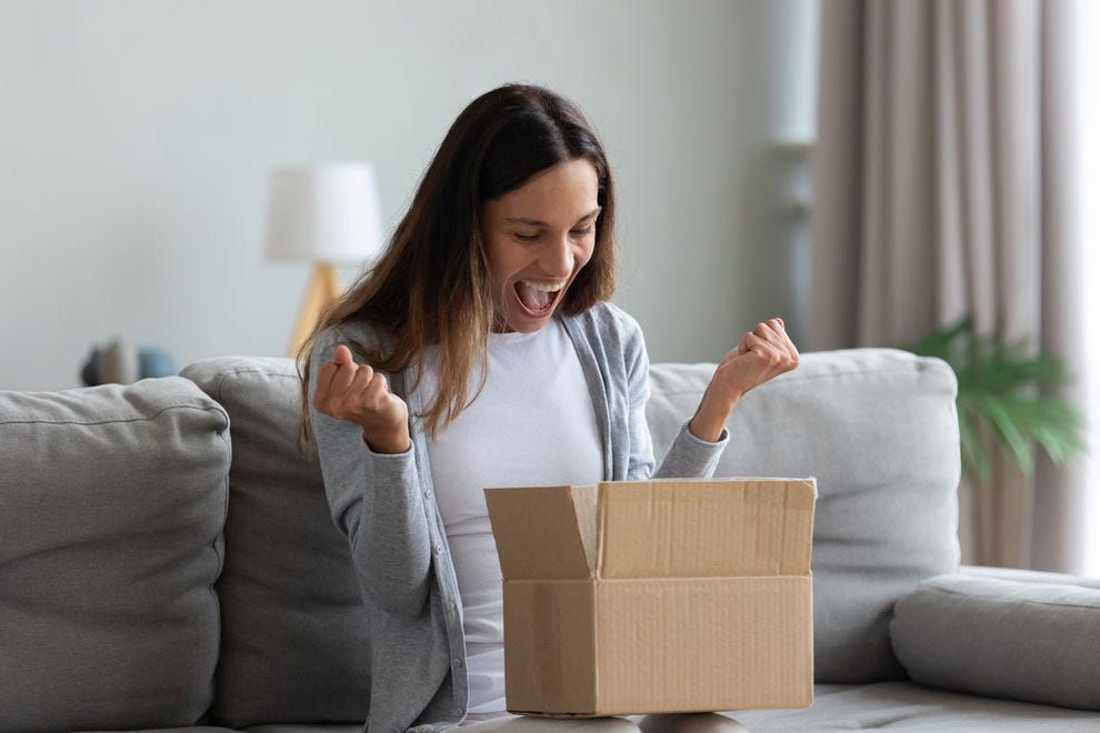 Women excitedly opens box