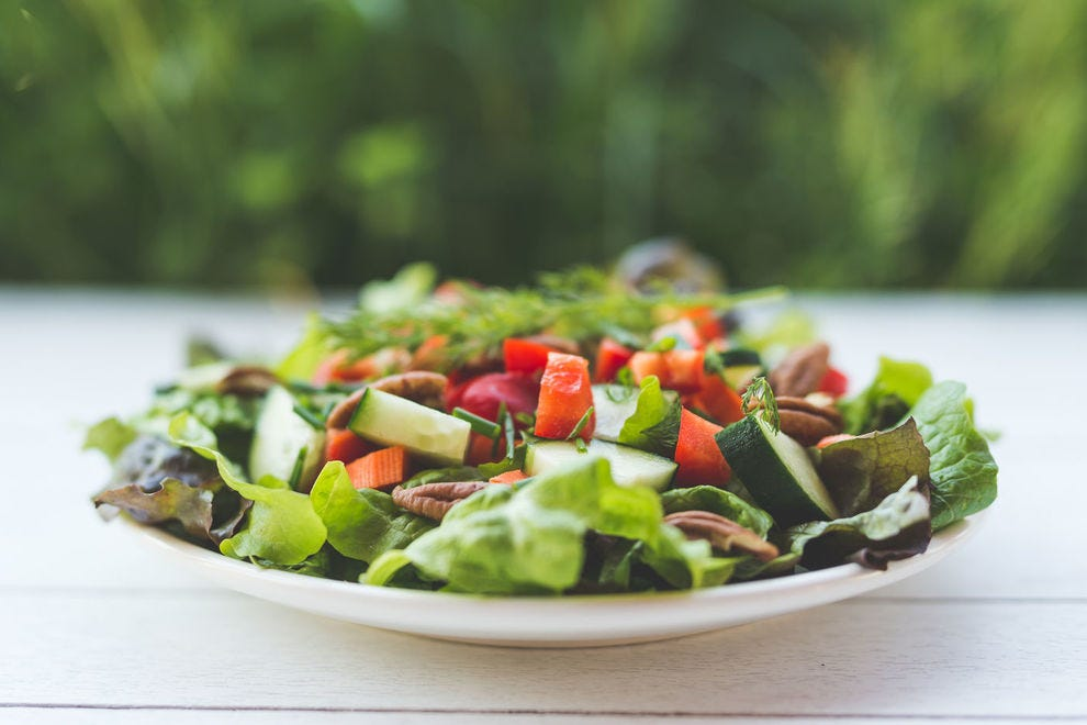 A garden salad with veggies and nuts