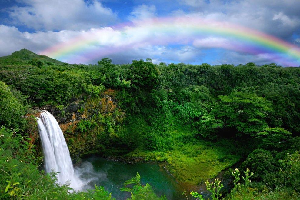 Rainbow over waterfall in Kauai