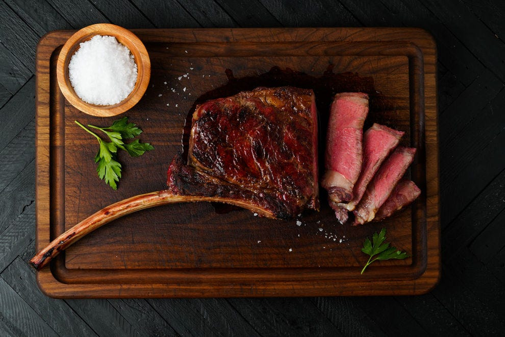 A dry-aged Tomahawk from Snake River Farms offers delicious meat beautifully presented