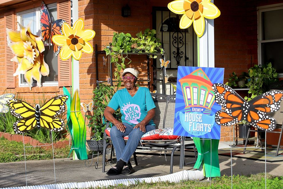 """Yvonne Milton sits in front of her Algiers house surrounded by the bee and flower creations of artists Re Howse and Bill Tucker as New Orleanians create """"house floats"""""""