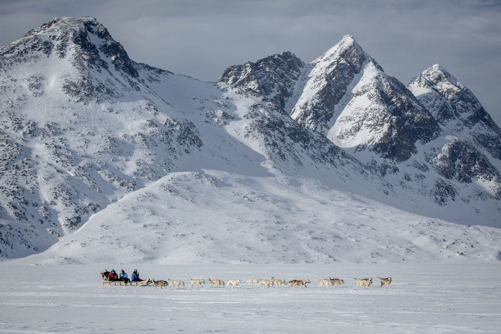 Dog sledding under remote peaks in the Tasiilaq part of East Greenland