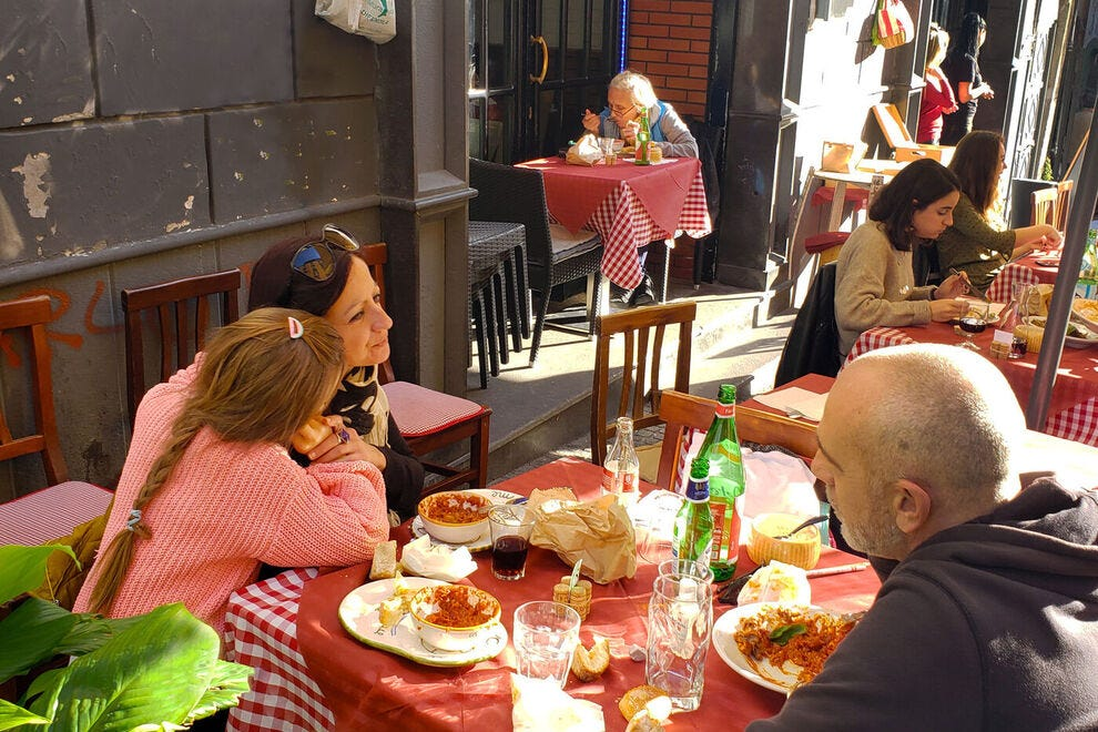 Outdoor dining in the historic center of Naples