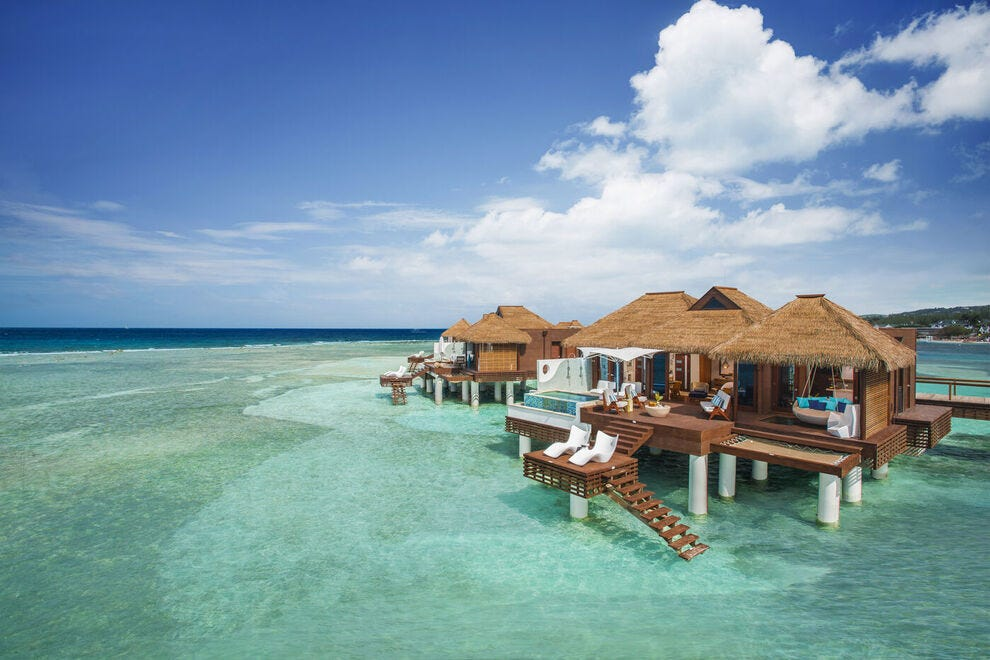 In Jamaica, over-the-water private island villas at Sandals Royal Caribbean come with floating water hammocks, see-through glass floors and infinity pools