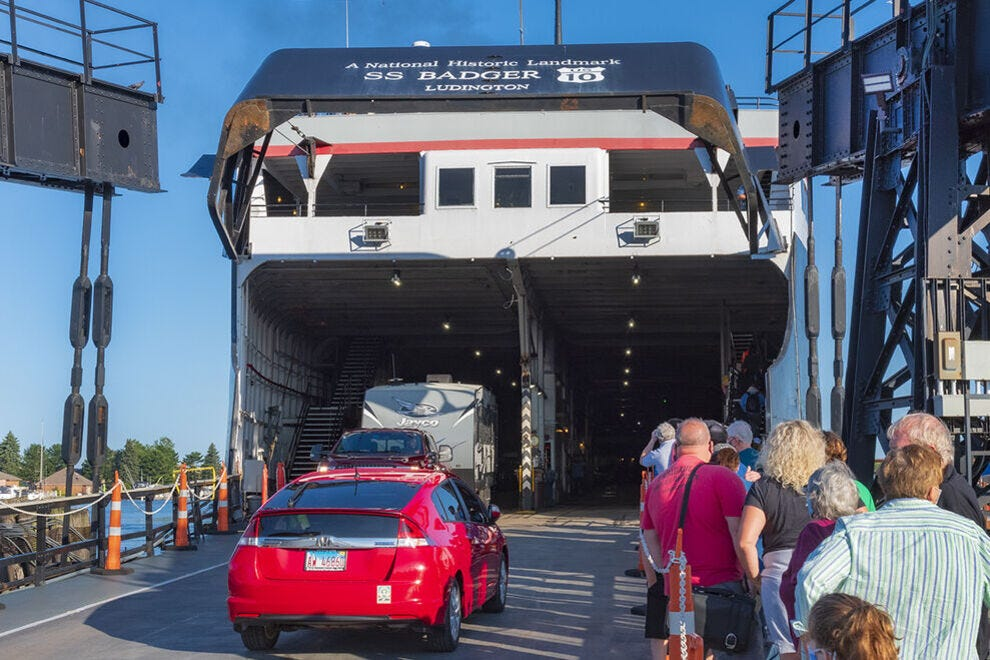 Locals, vehicles and visitors board the S.S. Badger in Ludington, Michigan