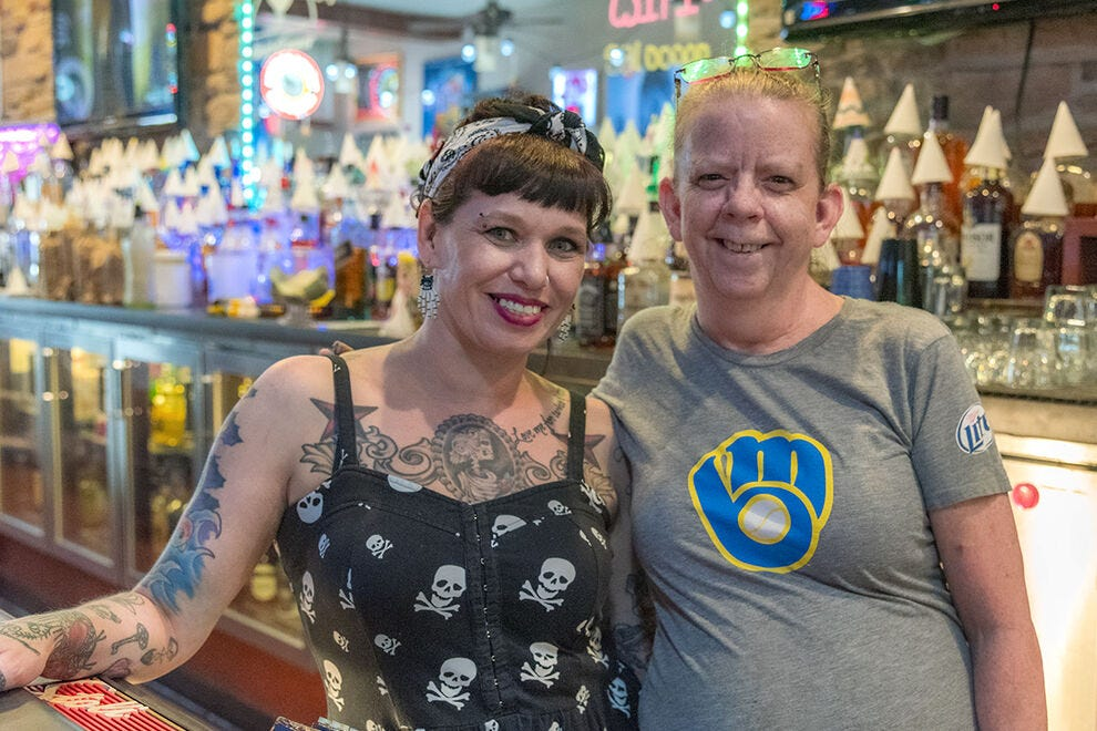 Bartender Michelle McDaniel and cook, Rebecca Bergin, welcome you to Sly's Midtown Salooon & Grill