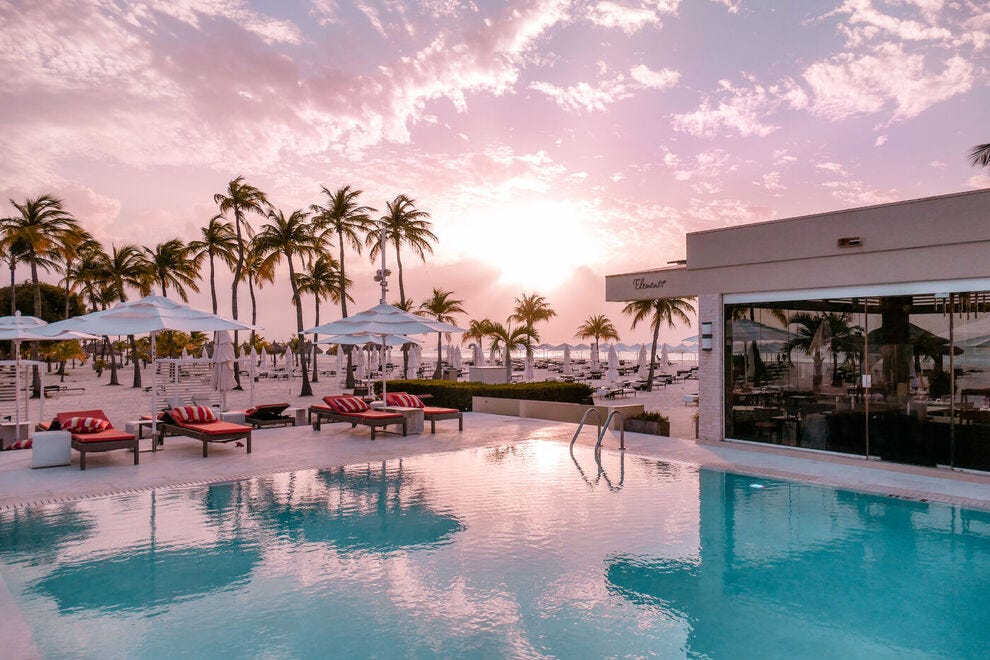 In Aruba, the pool at Bucuti & Tara Beach Resort is open around the clock to toast the cotton candy sky as the sun sets over Eagle Beach