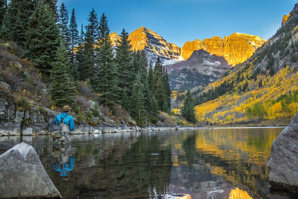 Fly fishing on Maroon Lake offers panoramic views of Maroon Bells