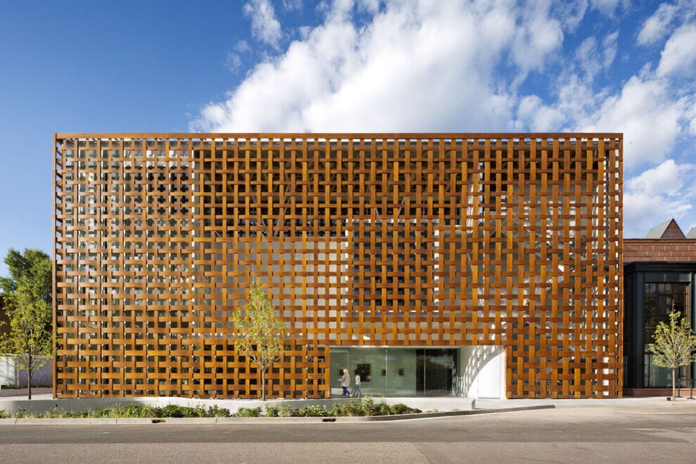 A lattice screen of paper, resin and wood veneer envelops two of the facades of the Aspen Art Museum