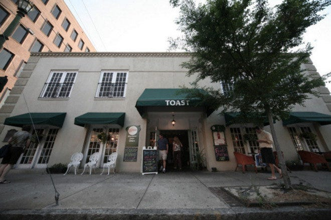 A view from the street of Charleston's Toast Restaurant, rated #1 in the city on Tripadvisor