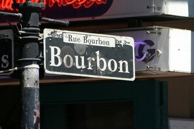 A signpost for one of America's favorite vacation destinations, Bourbon Street.